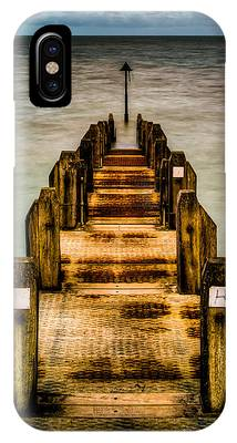 IPhone Case featuring the photograph Atlantic Ocean Engulfing A Walkway At Aberystwyth Uk by Dennis Dame