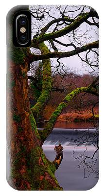 IPhone Case featuring the photograph Mossy Tree Leaning Over The Smooth River Wharfe by Dennis Dame