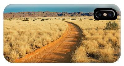 IPhone Case featuring the photograph African Sand Road by Benny Marty