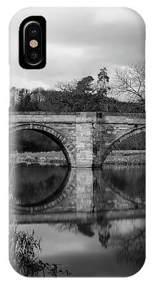 Reflecting Oval Stone Bridge In Blanc And White IPhone Case by Dennis Dame