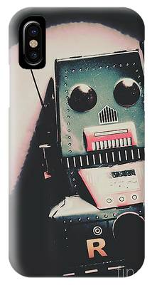 IPhone Case featuring the photograph Robotic Mech Under Vintage Spotlight by Jorgo Photography - Wall Art Gallery