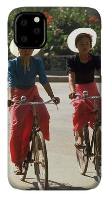 Photograph - Xishuangbanna Cyclists by Travel Pics