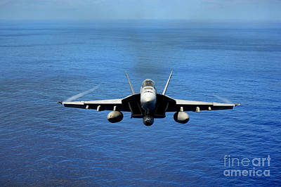 Poster featuring the photograph  A Fa-18 Hornet Demonstrates Air Power. by Paul Fearn