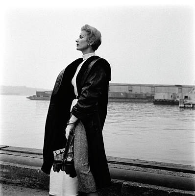 A Model Standing On A Dock In A Leather Coat Poster by Richard Rutledge