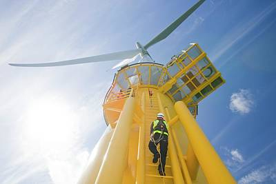 A Worker Climbs A Turbine Poster by Ashley Cooper
