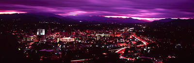 Aerial View Of A City Lit Up At Night Poster by Panoramic Images