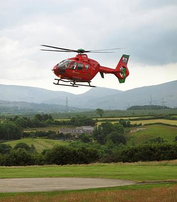 Air Ambulance Taking Off From Helipad Poster