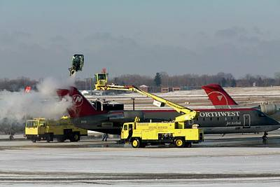 Airplane De-icing Poster by Jim West