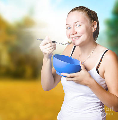 Attractive Young Blond Woman Eating Oatmeal Poster