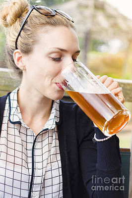 Attractive Young Woman Sipping From Beer Mug Poster