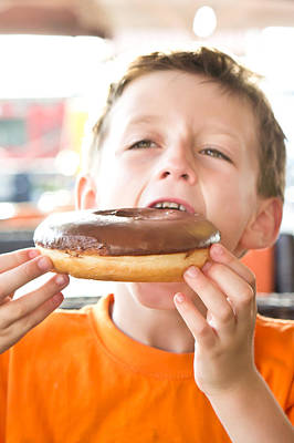 Boy With Donut Poster
