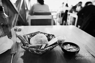 breads and salsa inside la luna restaurant Punta Arenas Chile Poster