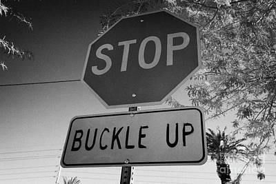 buckle up sign below stop sign in Las Vegas Nevada USA Poster