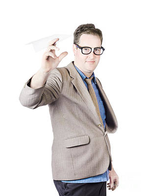 Businessman Holding Paper Airplane Poster by Jorgo Photography - Wall Art Gallery