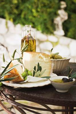 Cheese, Olives And Olive Oil On Table Out Of Doors Poster