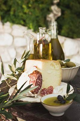 Cheese, Salami, Olives And Olive Oil On Table Out Of Doors Poster