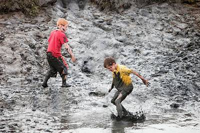 Children Playing In A Muddy Creek Poster by Ashley Cooper