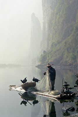 Comorant Birds Sitting On Fisherman's Boat In Li River Poster