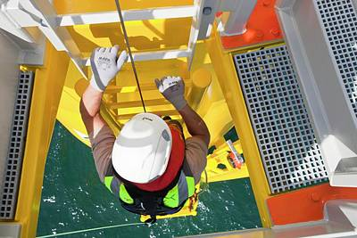 Executive Climbs A Wind Turbine Poster by Ashley Cooper