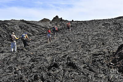 Group Of Hickers Walking On Cooled Lava Poster by Sami Sarkis