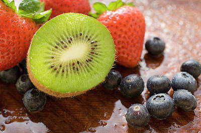 Half A Kiwi Fruit, Blueberries And Strawberries Poster