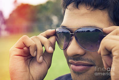 Handsome Man Putting On Summer Eyewear Poster by Jorgo Photography - Wall Art Gallery
