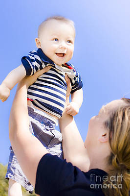 Happy Baby Held Up To The Sky Poster by Jorgo Photography - Wall Art Gallery