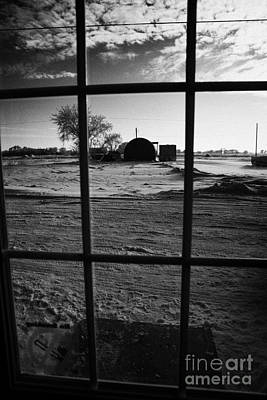 looking out through door window to snow covered scene in small rural village of Forget Saskatchewan  Poster