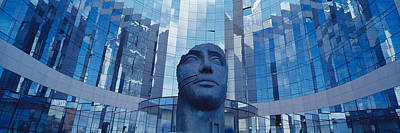 Low Angle View Of A Statue In Front Of Poster by Panoramic Images