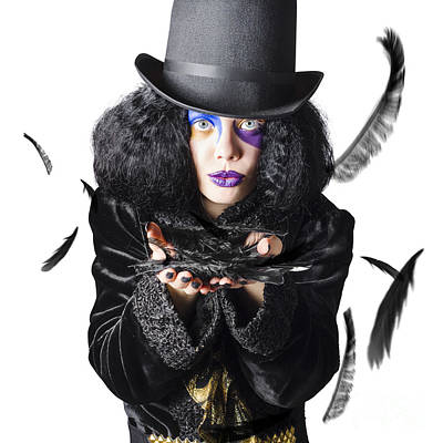 Magician Blowing Feathers Poster by Jorgo Photography - Wall Art Gallery