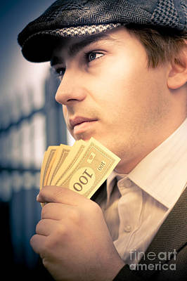 Man Holding Money Making A Financial Decision Poster by Jorgo Photography - Wall Art Gallery