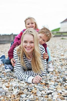 Mother With Children On Beach Poster