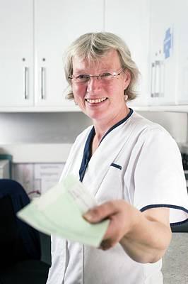 Nurse Handing Out Prescription Poster