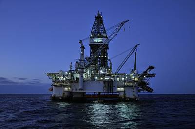 Oil Rig At Night Poster
