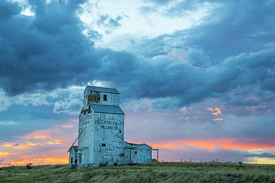Old Granary With Sunset Clouds Poster by Chuck Haney