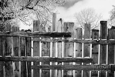 old patched up wooden fence using old bits of wood in snow Forget Saskatchewan Canada Poster