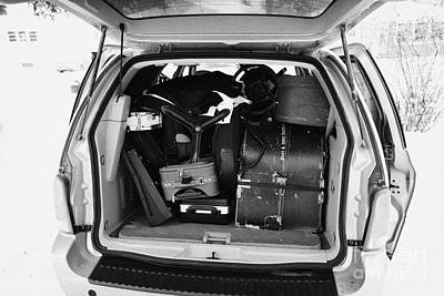 packing musicians equipment into mpv vehicle in Regina Saskatchewan Canada Poster by Joe Fox