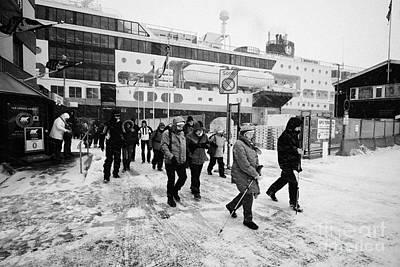 Passengers In A Snow Blizzard Leaving The Hurtigruten Passenger Terminal Hammerfest Finnmark Norway  Poster