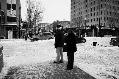 people waiting to cross snow covered intersection crosswalk city street Saskatoon Saskatchewan Canad Poster