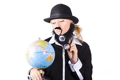 Person Examining World Globe On White Poster by Jorgo Photography - Wall Art Gallery
