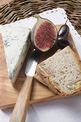 Piece Of Blue Cheese, Half A Fig, Olives And Bread Poster