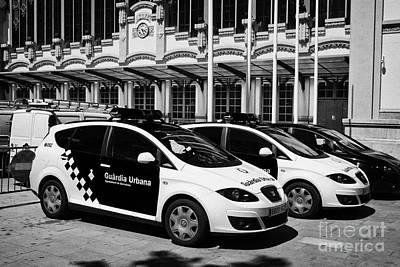 policia guardia urbana patrol cars outside estacio del nord station Barcelona Catalonia Spain Poster by Joe Fox