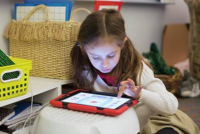 Primary School Girl Using Tablet Poster