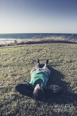 Relaxing Man Laying Down On Tasmanian Coast Field Poster