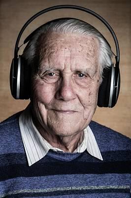 Senior Man Wearing Headphones Poster