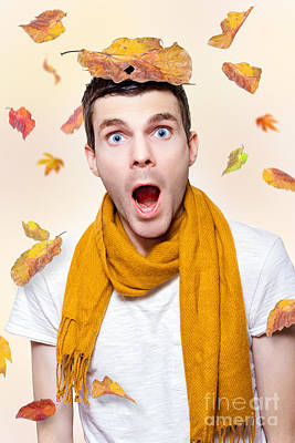 Shocked Man Playing In Falling Autumn Leaves Poster