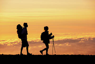 Silhouettes Of Two Hikers Poster