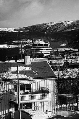 Snow Covered Street Of Traditional Wooden Houses Looking Down To Hurtigruten Ship In Kirkenes Harbou Poster