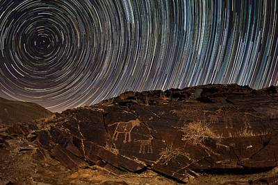 Star Trails Over Rock Carvings Poster
