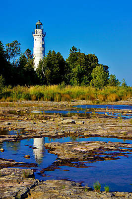 The Cana Island Lighthouse In Baileys Harbor Reflective Waters. Poster by Carol Toepke